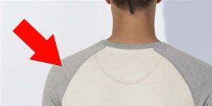 Une flèche rouge pointe les coutures diagonales d'une manche raglan