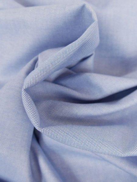 Zoom sur le tissu Oxford, mélange de fils colorés et de fils blancs pour un aspect quadrillé très élégant